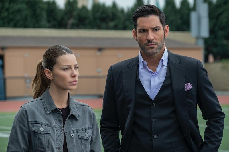 Chloe Decker (Lauren German) and Lucifer Morningstar (Tom Ellis) stand next to each other, looking serious