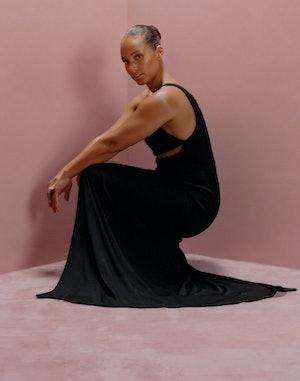 Alicia Keys wears a black Brandon Maxwell dress for Bustle's cover.
