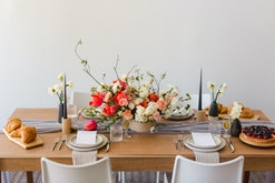 beautiful table spread with pink pink and white floral centerpiece