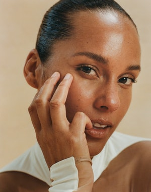 A closeup of Alicia Keys wearing a white Mugler top for Bustle's cover shoot.