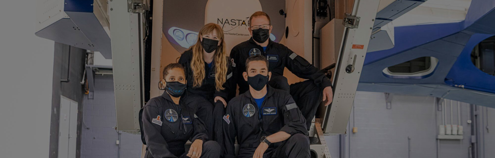 The four members of the Inspiration4 mission pose for a photo after centrifuge training.