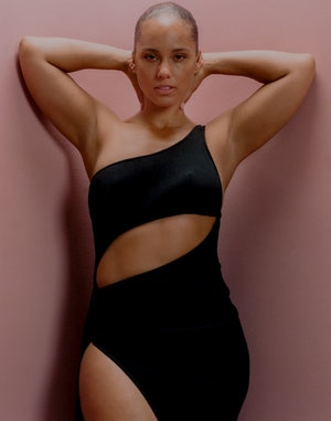 Alicia Keys poses wearing a black Brandon Maxwell dress for Bustle's cover.