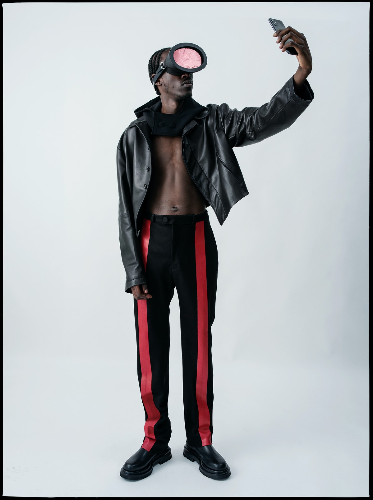 Unknown T wears a Maximilian jacket, pants, and hood; Nasir Mazhar for Maximilian goggles; Giorgio A...