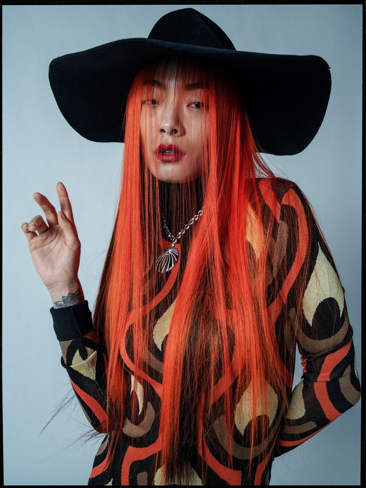Rina Sawayama wears a Paco Rabanne dress; Bijou Van Ness hat; Bulgari necklace.  Photographed by Tim Walker in March 2020. Styled by Sara Moonves.