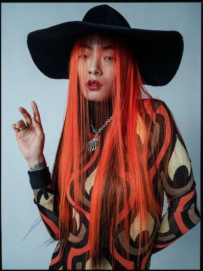 Rina Sawayama wears a Paco Rabanne dress; Bijou Van Ness hat; Bulgari necklace.  Photographed by Tim...