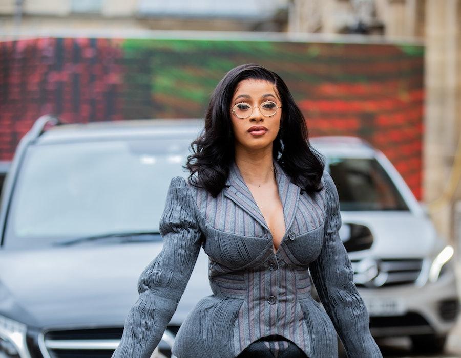PARIS, FRANCE - SEPTEMBER 29: American rapper Cardi B is seen wearing grey skirt, blazer, black bag, sunglasses outside Thom Browne during Paris Fashion Week Womenswear Spring Summer 2020 on September 29, 2019 in Paris, France.