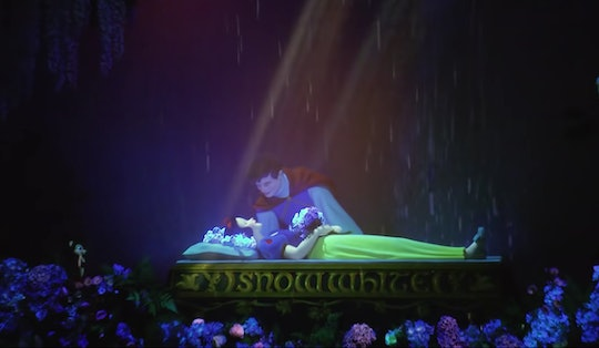 Snow White lies sleeping under an enchanted spell as her Prince Charming looks over her in a scene from Disneyland's newly revamped Snow White ride.