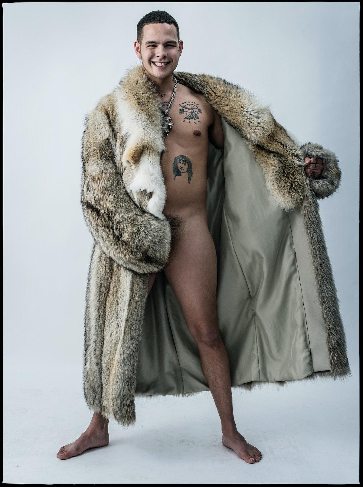 Slowthai wears a Louis Vuitton Men's coat.