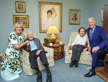 The Bidens and the Carters looking big and small