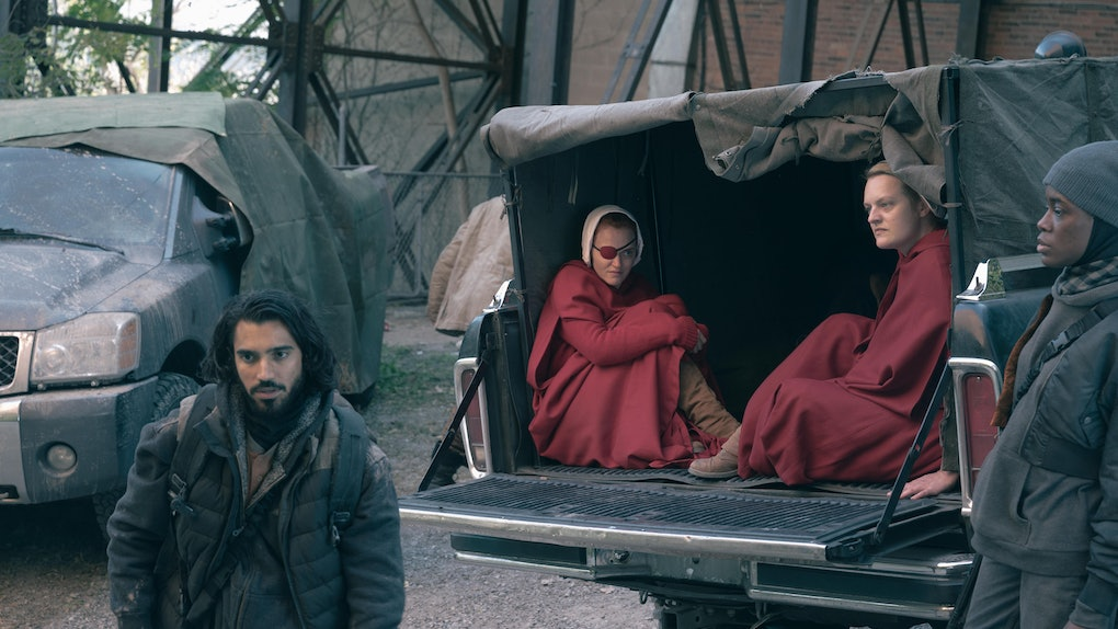 Omar Maskati, Elisabeth Moss, Madeline Brewer, and Nona Parker Johnson in The Handmaid's Tale