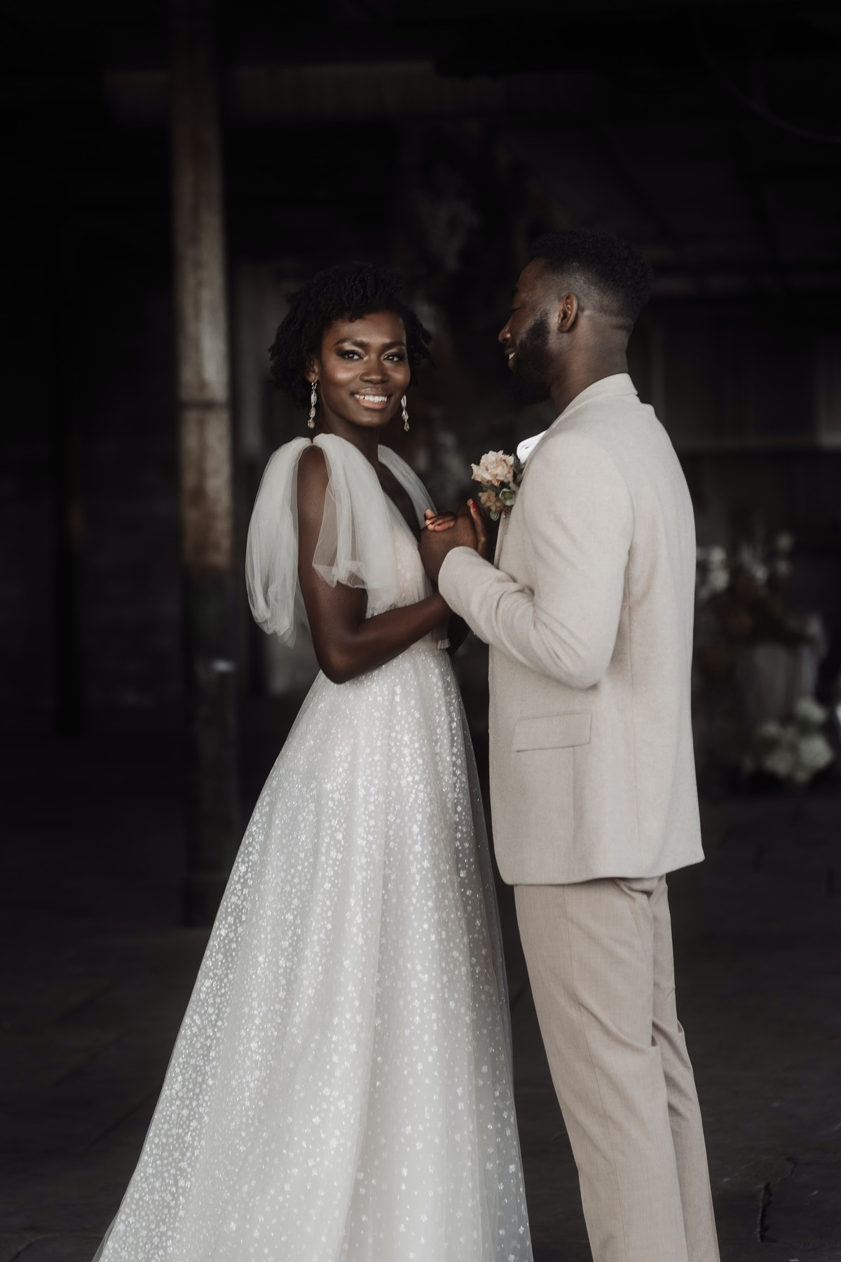 Groom gazing at bride, who is wearing graduated drop earrings. Photographer @emmaryanphotographer  P...