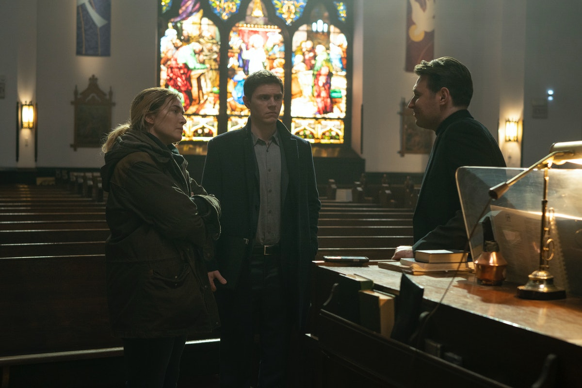 Kate Winslet as Detective Sergeant Mare Sheehan, Evan Peters as Det. Colin Zabel and James McArdle as Deacon Mark Burton in Mare of Easttown