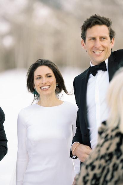 Bride and groom smiling. Bride is wearing turquoise chandelier earrings.