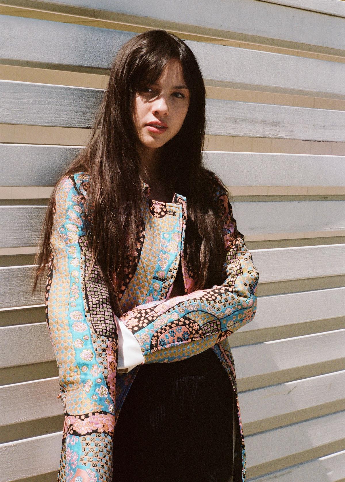 Olivia Rodrigo in a Dior coat; Fendi shirt; Atlein pants.