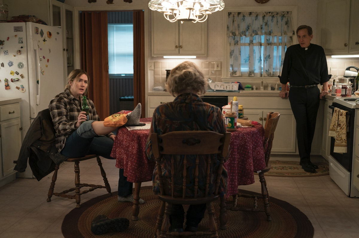 Kate Winslet as Detective Sergeant Mare Sheehan, Jean Smart as Helen Fahey, and Neal Huff as Father Dan Hastings in Mare of Easttown