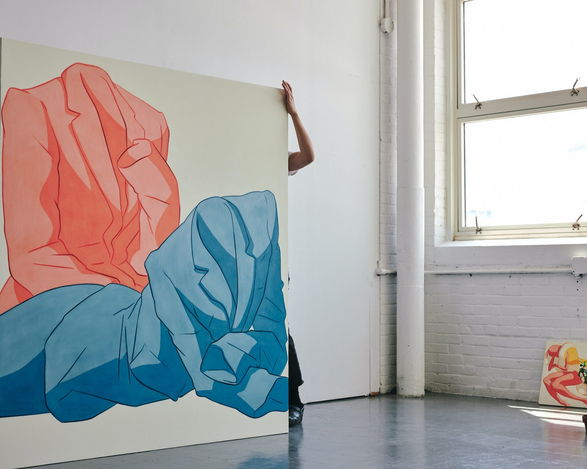 Ivy Haldeman moving a painting.