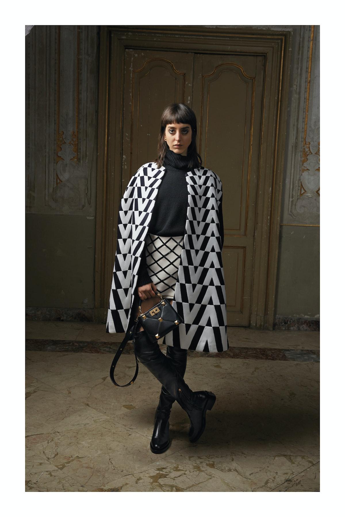Model in black and white Valentino cape