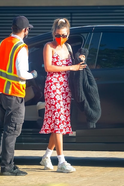 Hailey Bieber out for dinner in Nobu Malibu on May 5, wearing red Hawaiian print slip dress from Holiday The Label.