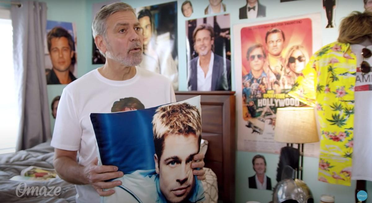 George Clooney holding pillow of Brad Pitt