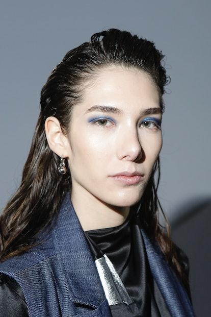 model backstage fashion week