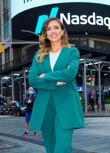 Jessica Alba in a green power suit at Nasdaq.