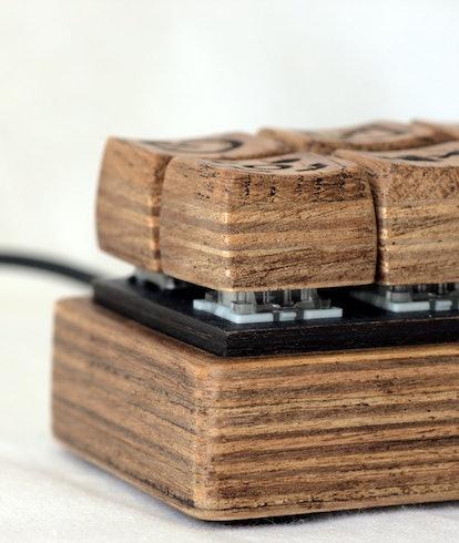 This custom mechanical keyboard is made of wood.
