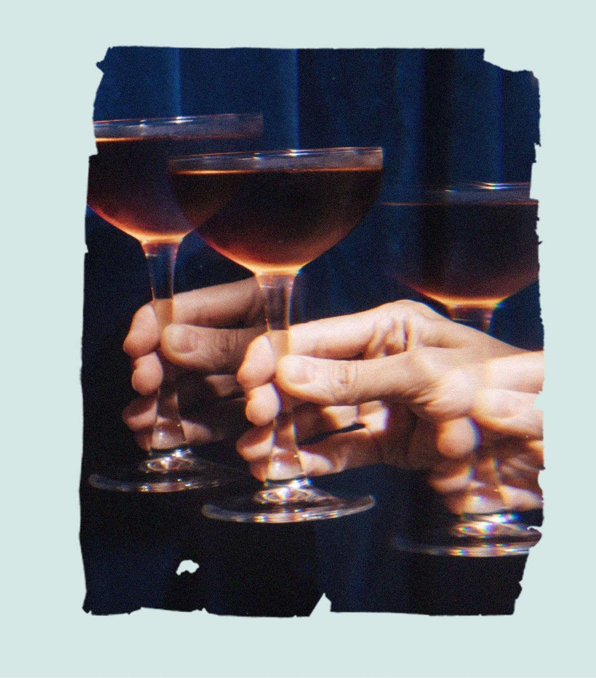 A person's hand holds up a glass of dark liqueur. Here's how Millennial women feel about sobriety in 2021.