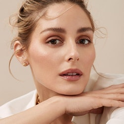 portrait of Olivia Palermo wearing her beauty line