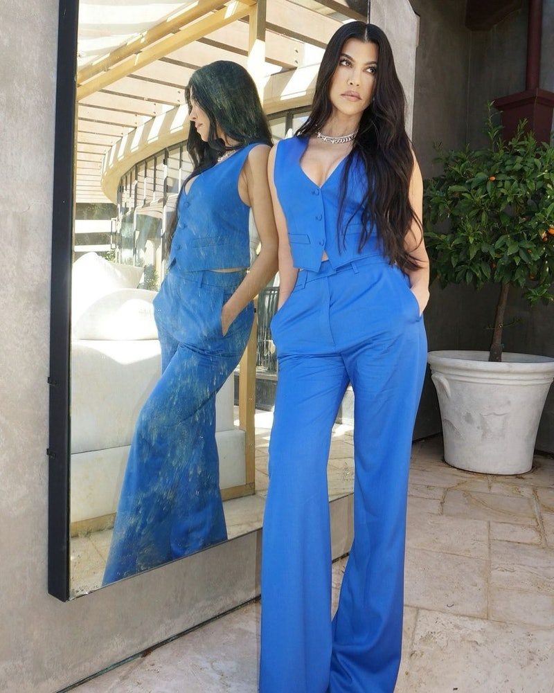 Kourtney Kardashian in a blue two-piece set.