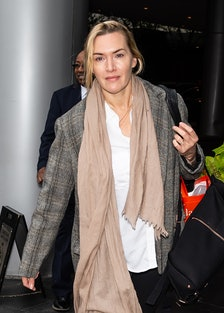 Kate Winslet walking in Philly, wearing a tan scarf
