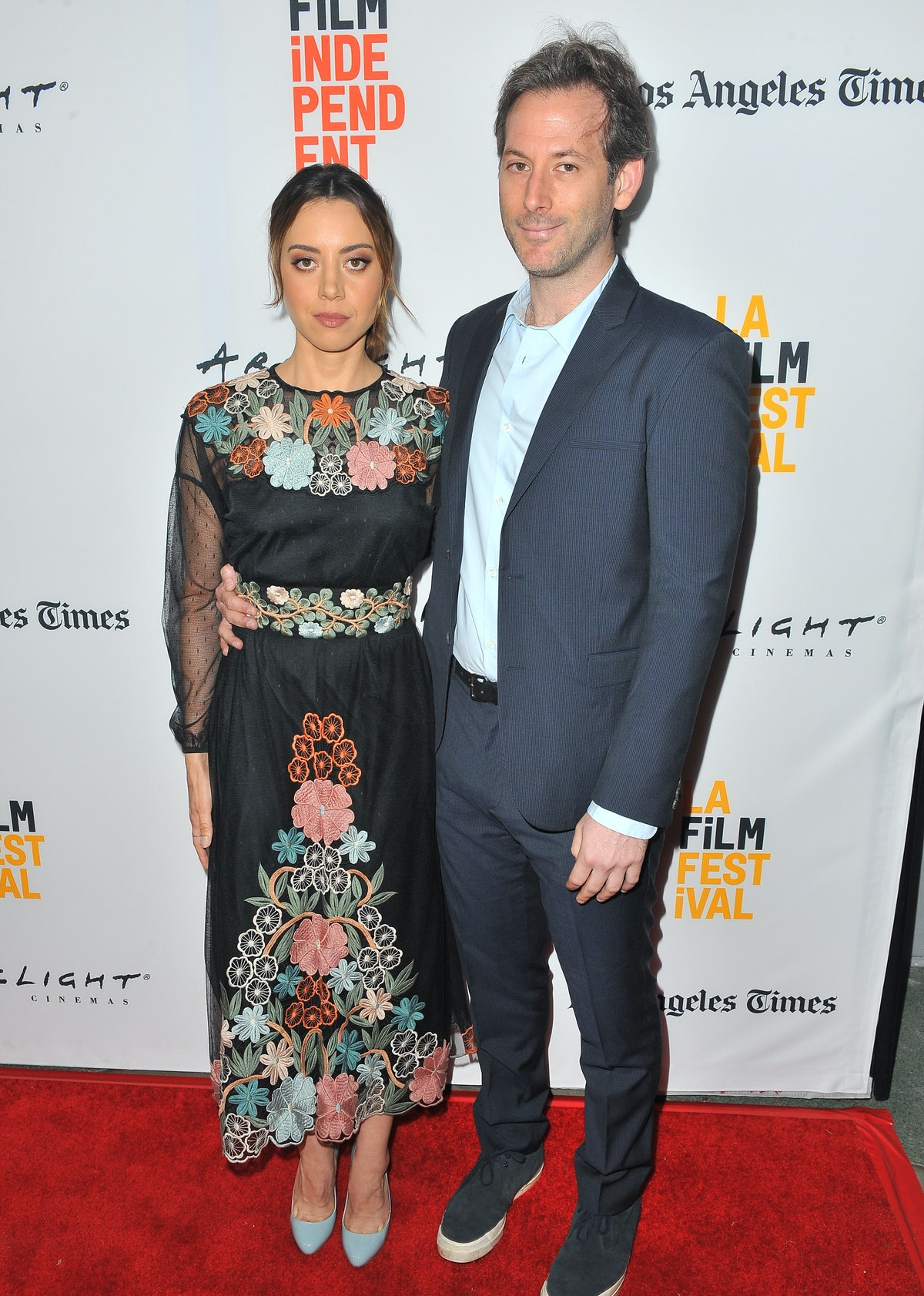 Aubrey Plaza in a floral dress, Jeff Baena in a suit