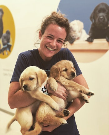Female researcher holds puppies