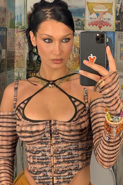 How to wear the Y2K-style zigzag hair part like Bella Hadid.