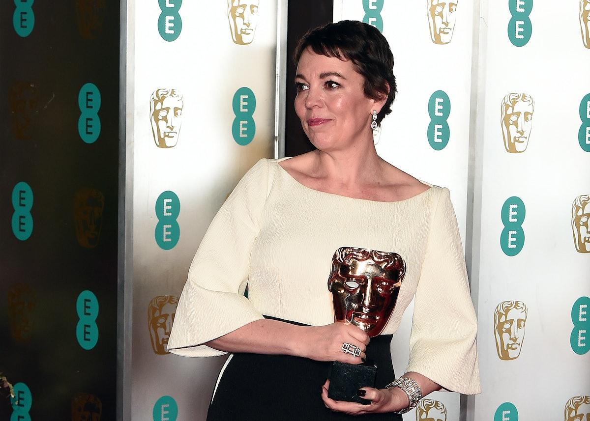 Olivia Colman holding a BAFTA
