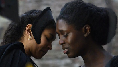 Madge Shelton (played by Thalissa Teixeira) and Anne Boleyn (played by Jodie Turner-Smith)