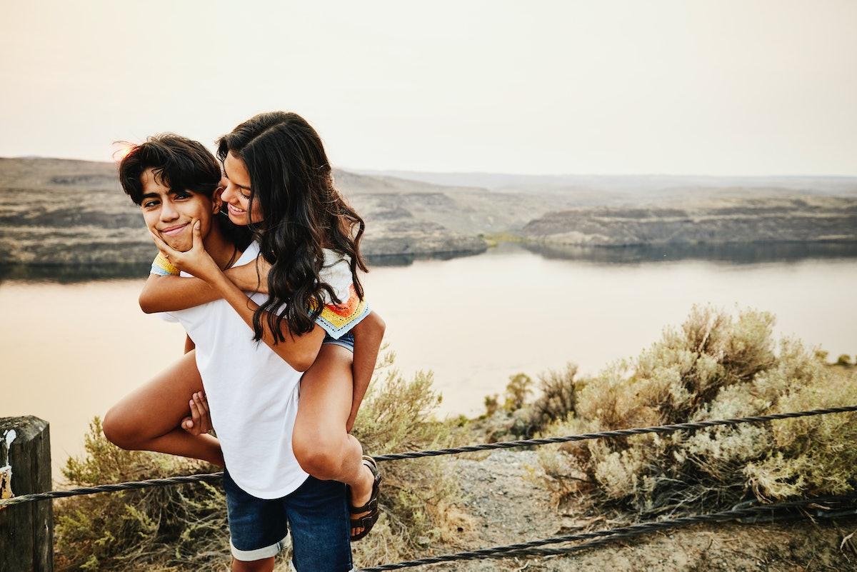 Young Gemini-Scorpio couple giving a piggyback ride.