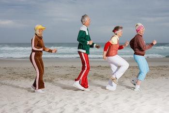 seniors exercising on beach