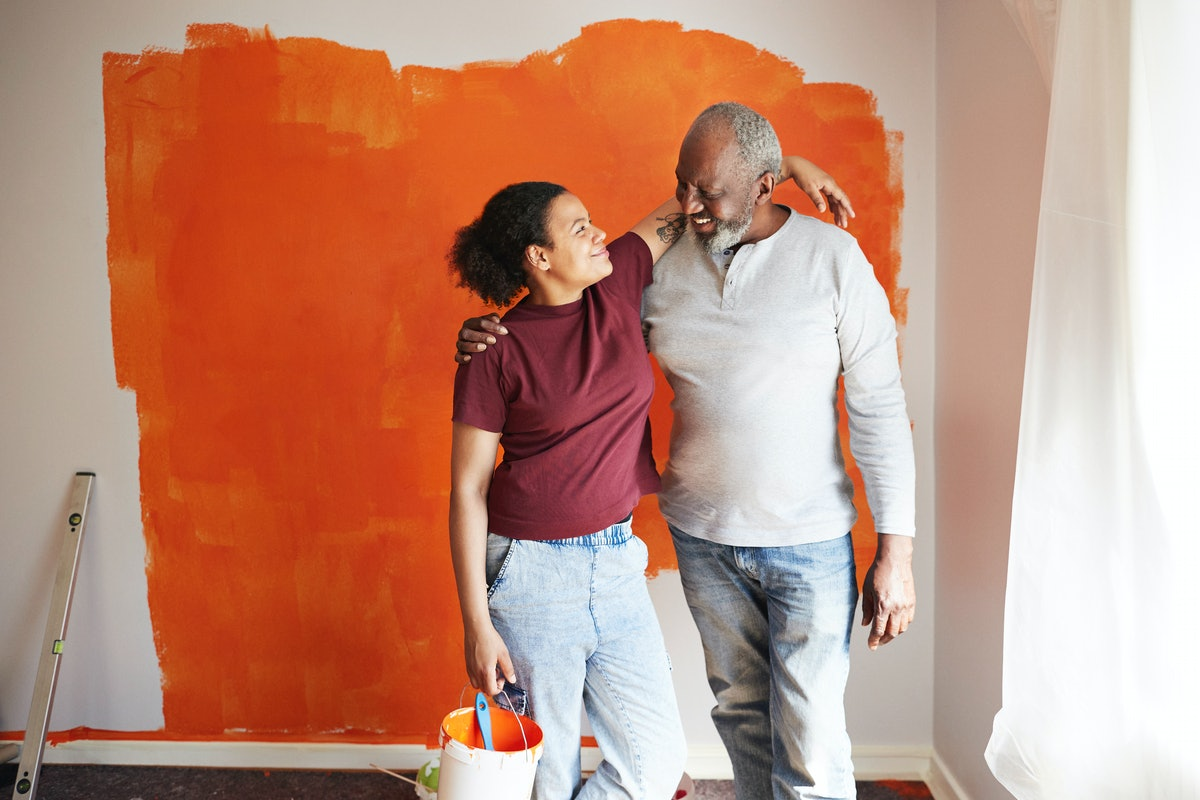 Father-daughter duo happy while painting ahead of Father's Day 2021, in need of Instagram captions.