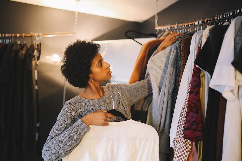 Woman looks in her wardrobe.
