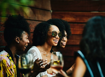Young women drinking during happy hour, in need of Instagram captions.