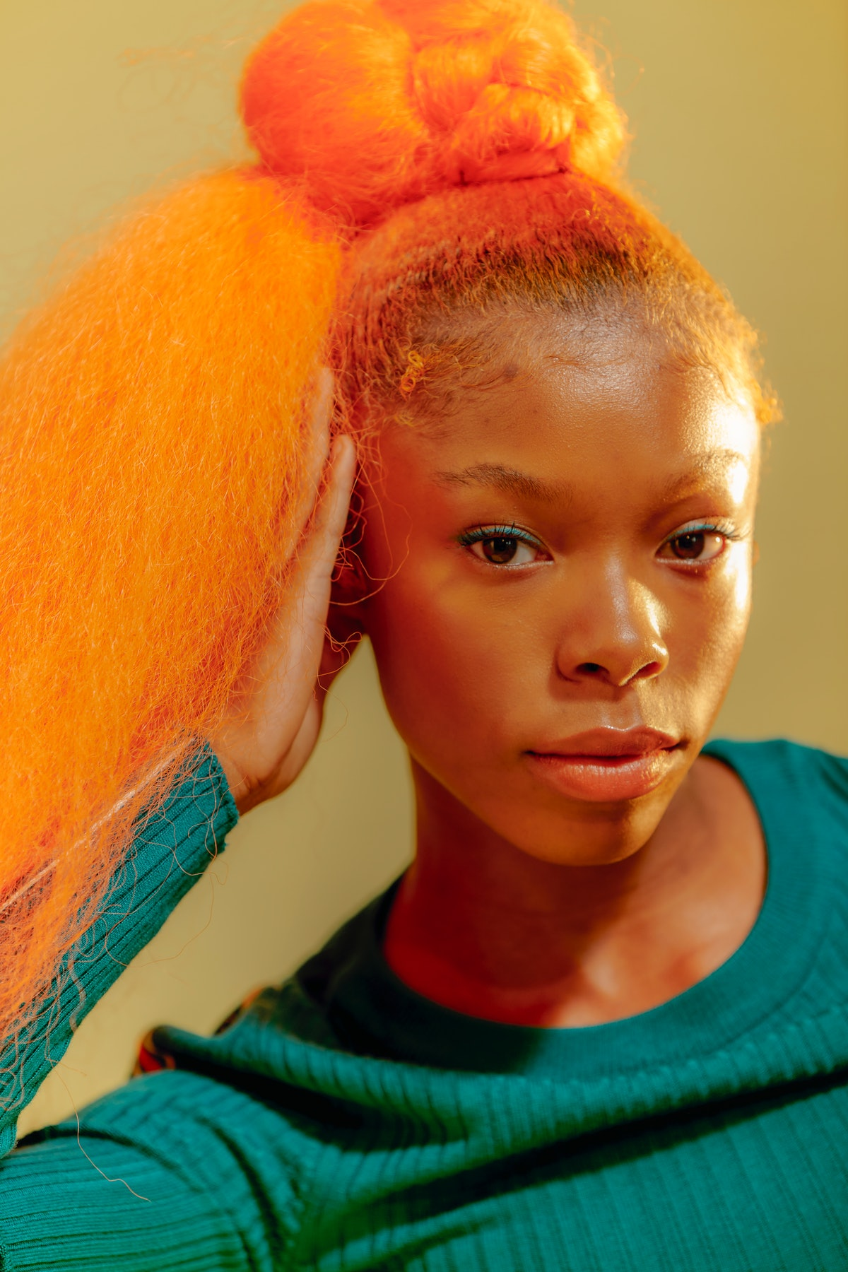 Intense young woman with orange hair and emotional Cancer qualities.