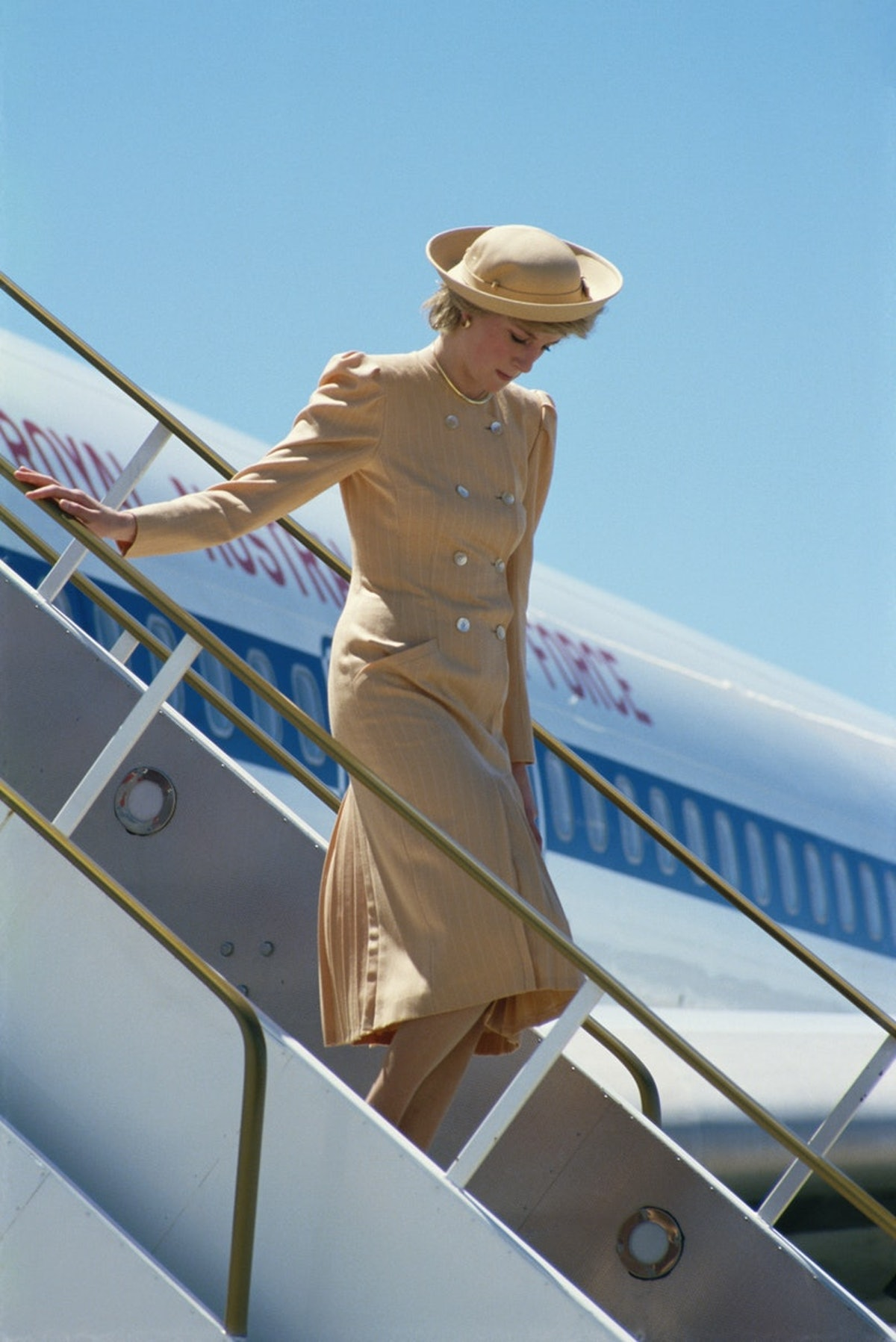 Princess Diana getting off an airplane