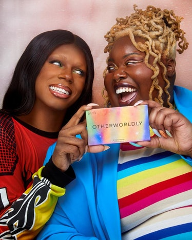 Two Black models wearing makeup and holding up a Pride beauty product from queer-owned beauty brand ...