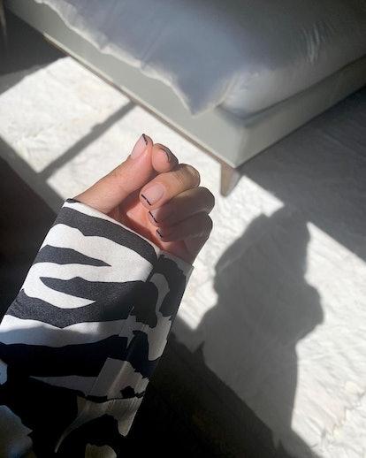 Kourtney Kardashian black nail tips manicure