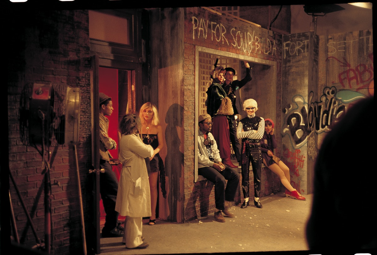 """Debbie Harry, Jean-Michel Basquiat, and Fab 5 Freddy with others on the set of Blondie's """"Rapture"""" music video"""