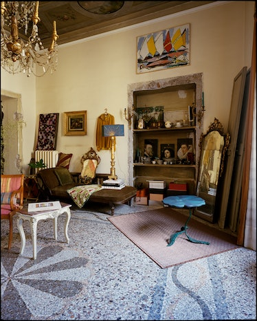 a living room in Rome filled with art and antiques