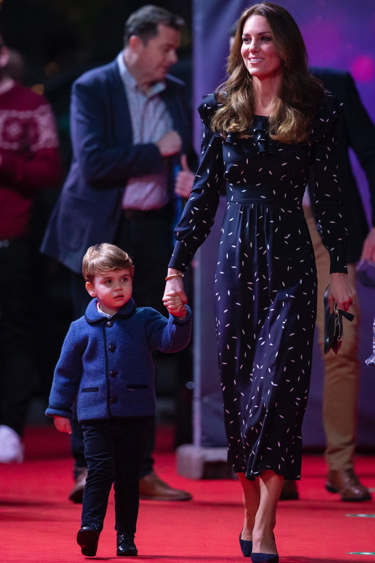 Prince Louis holding hands with his mom, Kate Middleton