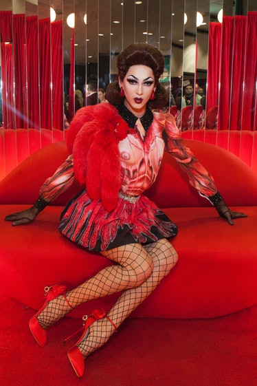 Violet Chachki in booth.