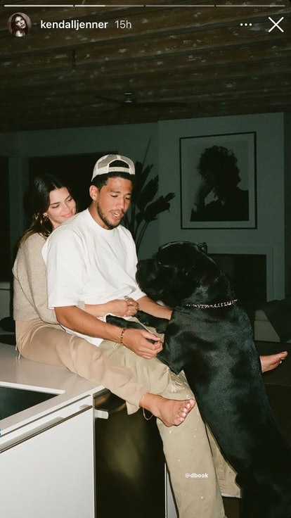 Kendall Jenner cuddles boyfriend Devin Booker.