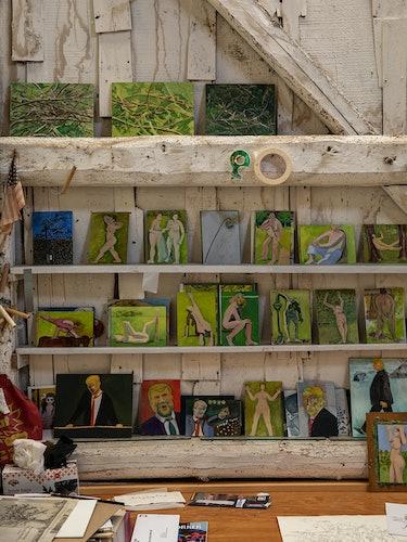 paintings on a shelf